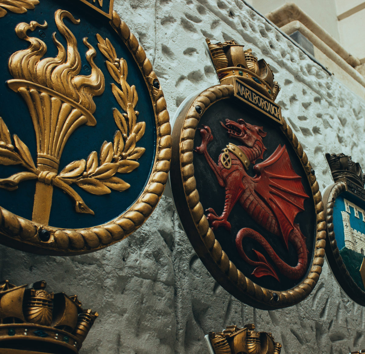 ship badges hanging on wall